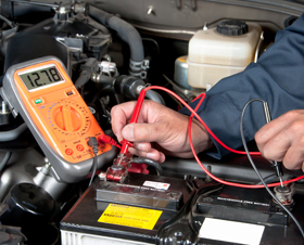 Man diagnosing engine of a vehicle